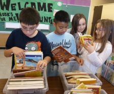 Danny, Tanner, Sydney and Anya check out the variety of books on display.