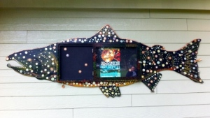 This beautiful salmon-shaped bulletin board, hanging on the wall of the Slocan Park Field House, is an invitation for neighbours to connect with each other.