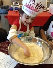 Chef Saman mixes the dough with the fanciest kitchen tool ever—her finger! Photo by Barb Finley