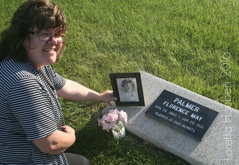 Loretta Houben beside her great- grandmother's grave in Saskatchewan.