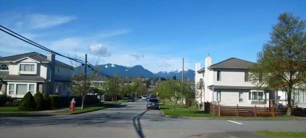 A spring day on a quiet street in Renfrew-Collingwood, with Grouse Mountain and Seymour Mountain in the background. Photos by Julie Cheng