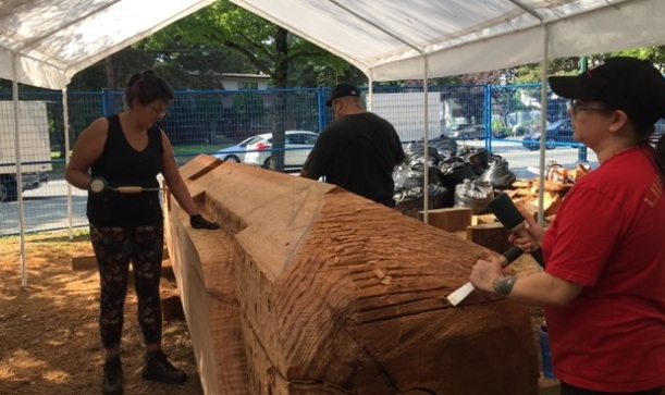 Carving begins on the cedar log